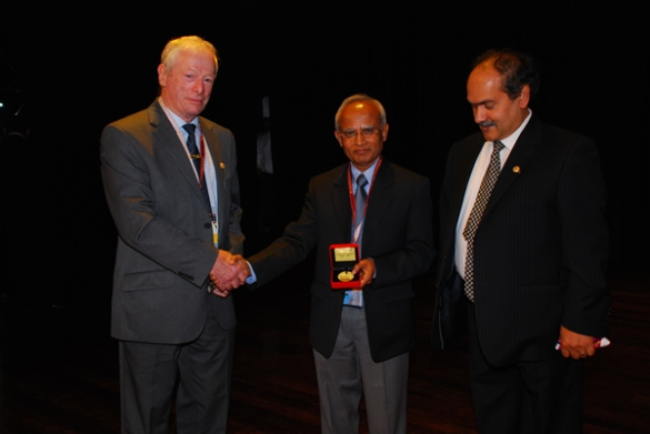 Prof Rahman (centre) receiving the William Johnson International Gold Medal. He is flanked by Prof Frank Travies (left), past president of AMPT and Prof Sarwar Hashmee (right), current president of AMPT.